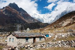 Nepalese building and Langtang peak Royalty Free Stock Images