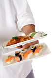 Nepalese chef male hand, oriental food plate Stock Images