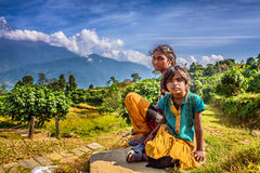 Nepalese children play in the Himalayas mountains near Pokhara Royalty Free Stock Photo