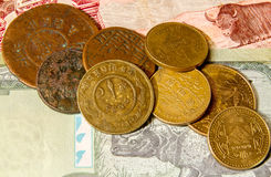 Nepalese coins on the banknotes. Royalty Free Stock Photo