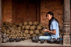 Nepalese craftswoman in Bhaktapur, Nepal Royalty Free Stock Image
