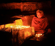 Nepalese elderly woman praying with candles. Kathmandu, Nepal on Stock Images