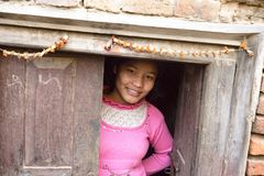 Nepalese girl outside the city of Bhaktapur, Nepal, December 2017 royalty free stock photography