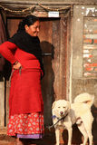 Nepalese lady and a dog Stock Photos