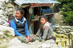 Nepalese little girl and her mother in the village. Children, small kid portrait outside in Nepal Royalty Free Stock Photos