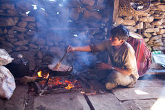 Nepalese man cooking Royalty Free Stock Photo