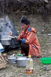 Nepalese man cooking Royalty Free Stock Photos