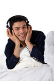 Nepalese man in pajamas, headphones Stock Image