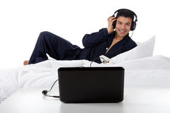 Nepalese man in pajamas, laptop Stock Images