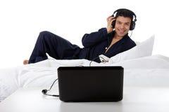 Nepalese man in pajamas, laptop Stock Images