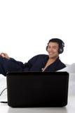 Nepalese man in pajamas, laptop Stock Photo