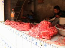 A Nepalese man waiting for customers to buy his meat, Nepal Stock Photo