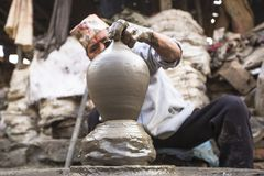 Nepalese man working in the his pottery workshop. Stock Images