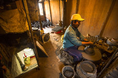 Nepalese man working in the his pottery workshop. More 100 cultural groups have created an image Bhaktapur as Capital of Nepal Art Royalty Free Stock Image