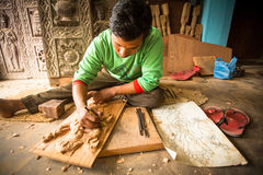 Nepalese man working in the his wood workshop. Royalty Free Stock Photography