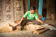 Nepalese man working in the his wood workshop. More 100 cultural groups have created an image Bhaktapur as Capital of Nepal Arts. Royalty Free Stock Photography