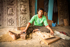 Nepalese man working in the his wood workshop. More 100 cultural groups have created an image Bhaktapur as Capital of Nepal Arts. Royalty Free Stock Photo