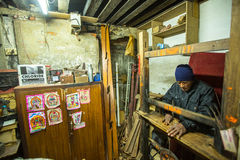 Nepalese man working in his wooden workshop. More 100 cultural groups have created an image of Bhaktapur as Capital of Nepal Arts. Royalty Free Stock Image