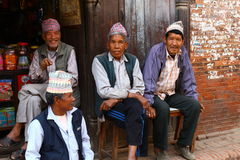 Nepalese men mingle on the side of the street Royalty Free Stock Images