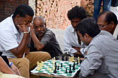 Nepalese men playing chess on the street Royalty Free Stock Photos