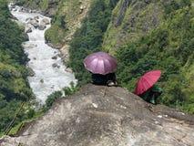 Nepalese men with umbrellas stock photo