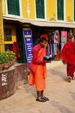 Nepalese monk standing at Boudhanath temple for receive donation Stock Image