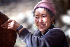 Nepalese peasant woman with basket Stock Photo