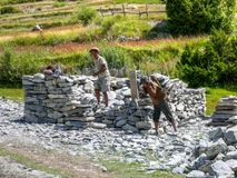 Nepalese people building stone house in Bhraka village, Nepal Stock Photo