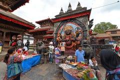 Nepalese people celebrating the Dasain festival in Kathmandu, Ne. KATHMANDU, NEPAL - OCTOBER 11: Hindu people celebrating the first day of the Dasain festival on Stock Photos