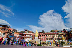 Nepalese people and foreign tourists and pilgrims visiting Buddhist Shrine Boudhanath Stupa. Nepal, Kathmandu Royalty Free Stock Photo