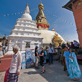 Nepalese people and foreign tourists and pilgrims visiting Buddhist Shrine Swayambhunath Stupa. Nepal, Kathmandu Royalty Free Stock Images