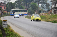 Nepalese People and foreigner and traffic on road Stock Image