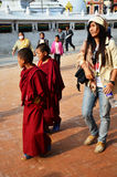Nepalese People and foreigner walking on Street of Boudhanath temple Royalty Free Stock Photos