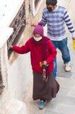 Nepalese people  walking around  Boudhanath stupa  in Kathmandu. Royalty Free Stock Photos