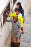 Nepalese people  walking around  Boudhanath stupa  in Kathmandu. Royalty Free Stock Images