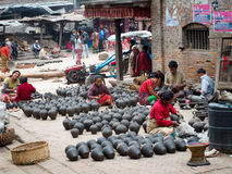 Nepalese people working in the her pottery workshop Stock Photos