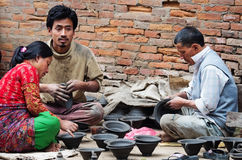 Nepalese people working in the pottery workshop Royalty Free Stock Photo