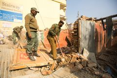 Nepalese police during a operation on demolition of residential slums, in Kathmandu, Nepal. Royalty Free Stock Photo