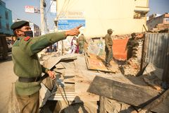 Nepalese police during a operation on demolition of residential slums, in Kathmandu, Nepal. Royalty Free Stock Photography