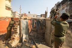 Nepalese police during a operation on demolition of residential slums,  in Kathmandu, Nepal. Stock Photos