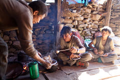 Nepalese porters eating porrige  Royalty Free Stock Photography