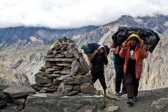 Nepalese porters at the pass Royalty Free Stock Image