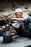 Nepalese  potter working in the his pottery workshop Royalty Free Stock Images