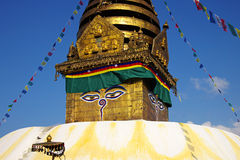 Nepalese stupa with prayer flags Royalty Free Stock Images