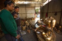 Nepalese tinman working in the his workshop, in Bhaktapur, Nepal. Royalty Free Stock Photo