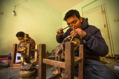 Nepalese tinman working in the his workshop,  in Bhaktapur, Nepal. Stock Images