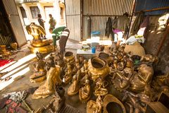 Nepalese tinman working in the his workshop, in Bhaktapur, Nepal. Royalty Free Stock Images