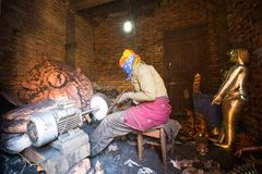 Nepalese tinmans working in the his workshop. More 100 cultural groups have created an image Bhaktapur as Capital of Nepal Arts. Stock Photo