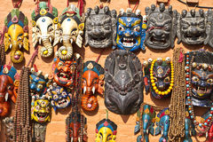 Nepalese traditional masks and souvenirs. Traditional masks represents various gods and other souvenirs in shop display, Kathmandu,Nepal Stock Photography