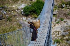 Nepalese woman on a bridge Stock Images